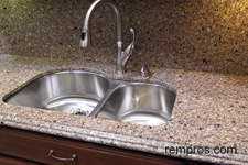 quartz-kitchen-countertop-with-quartz-backsplash-and-undermount-sink